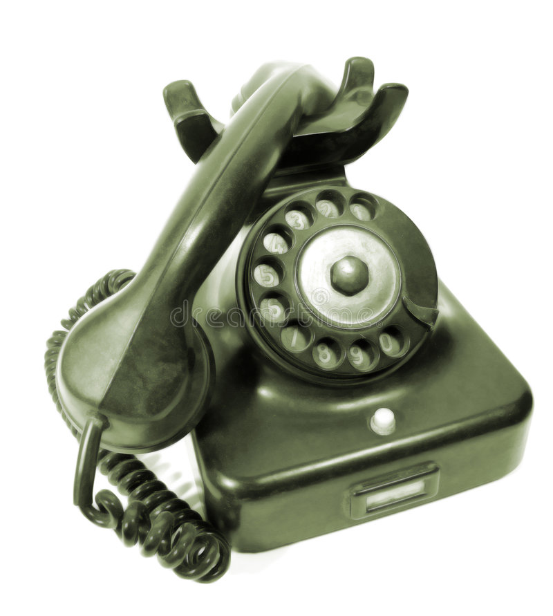Antique rotary dial telephone. View of an old, antique rotary dial telephone on a white background royalty free stock photo