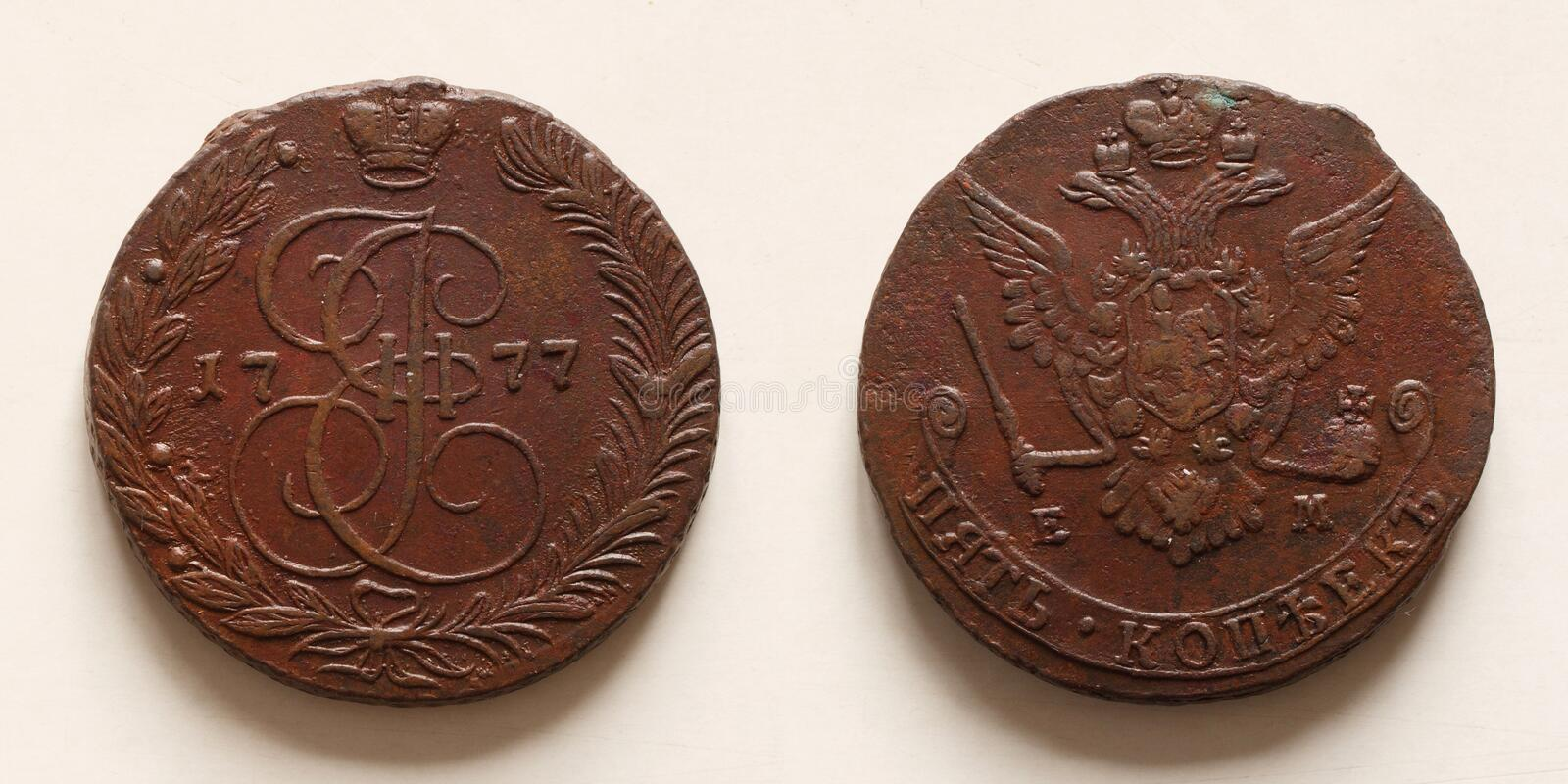 Antique russian coin 5 kopecks 1777. Eagle EM dark brown copper both sides stock image