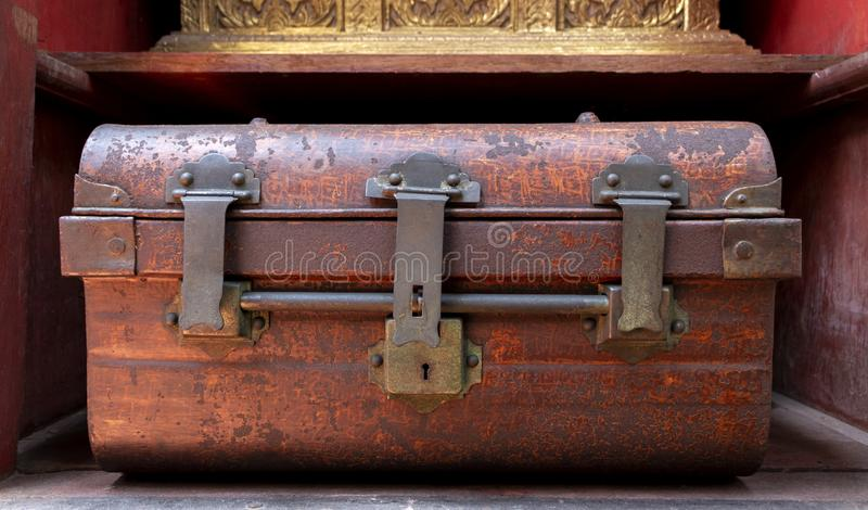 Antique rust iron metal lock box used to store valuables in travel royalty free stock photo