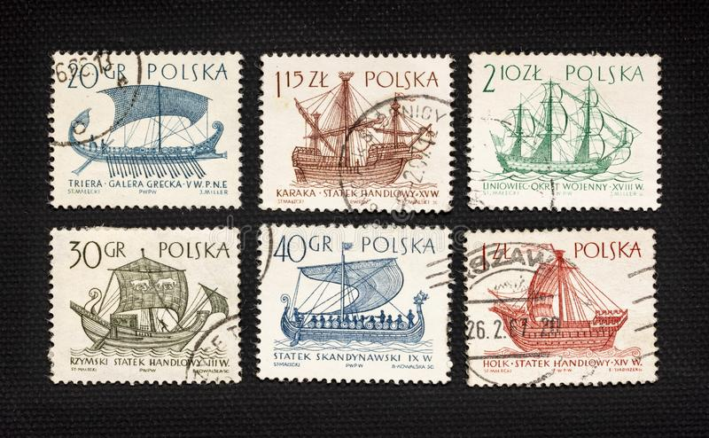 Antique sailing ships on post stamps stock photography