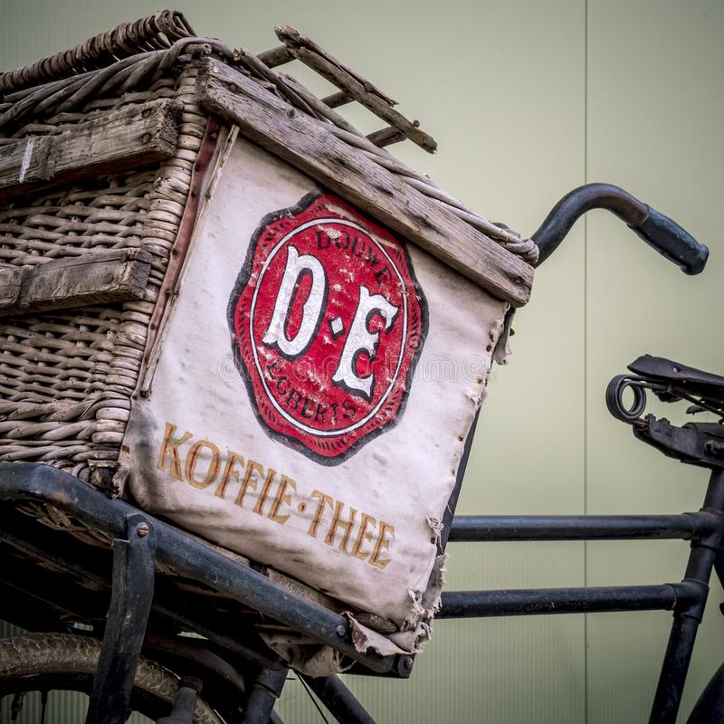 Antique sales bicycle for coffee and tea from Douwe Egberts stock photography