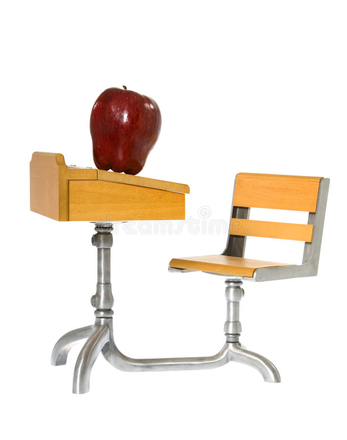 Antique School Desk with Shiny Red Apple royalty free stock image