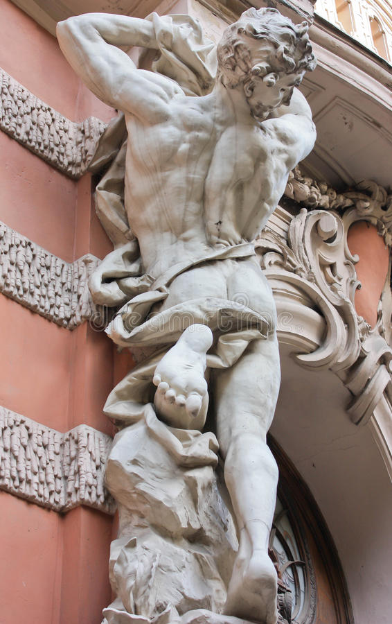 Antique sculpture Atlant. Atlant in the European architectural tradition of sculpture in the form of a man performing a decorative or functional role in royalty free stock photos