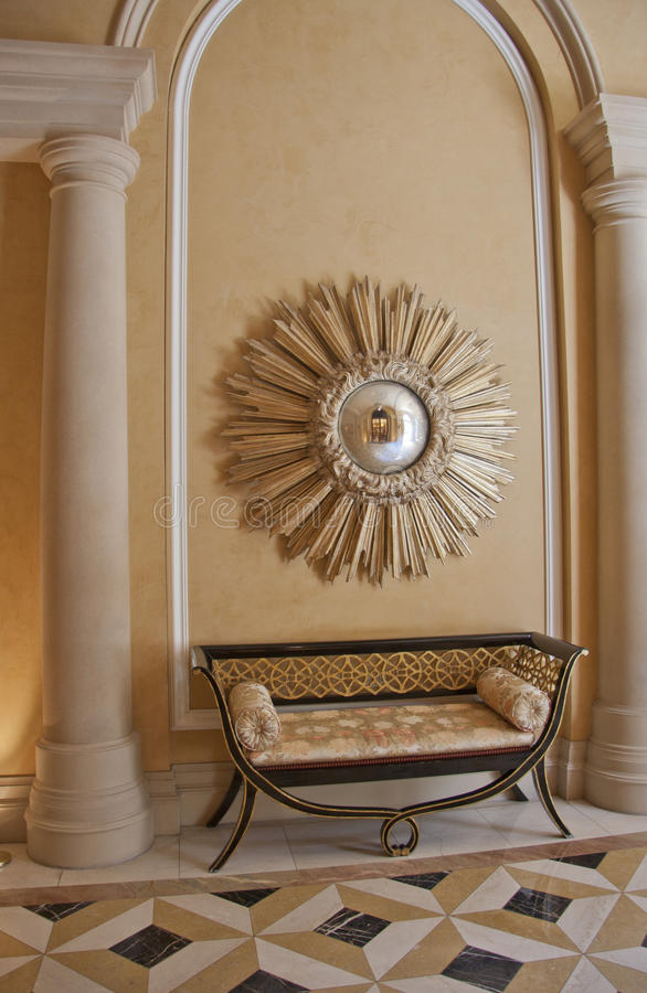 Antique settee and starburst convex mirror. Above royalty free stock photo