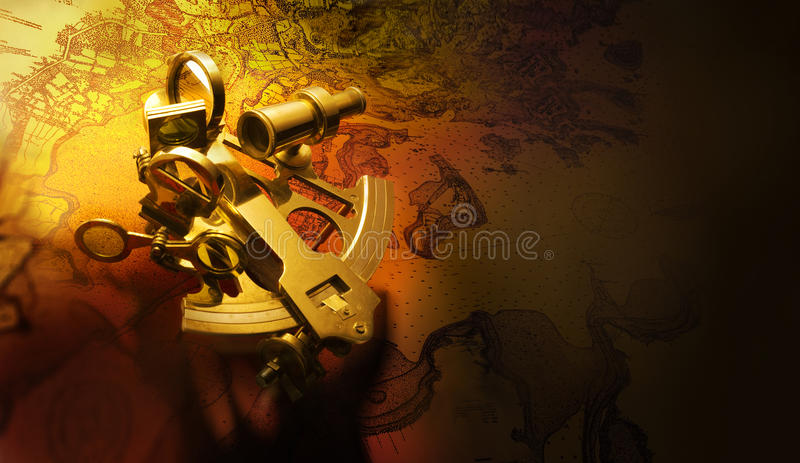 Antique sextant. Beautiful antique brass sextant shot on navigational map with space for copy