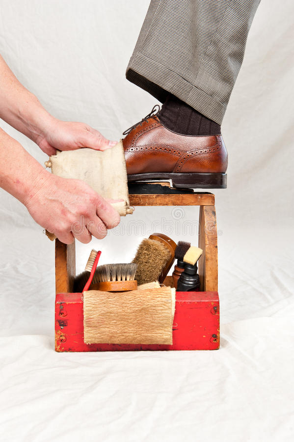 Antique Shoe Shine Box And Worker Royalty Free Stock Images