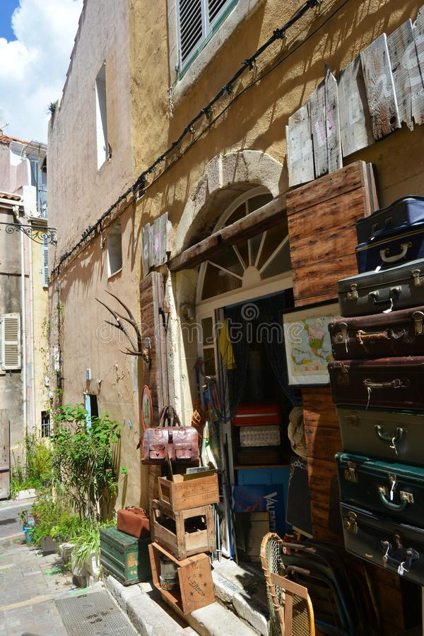 Antique shop in the old town of Marseille, France. Antique shop in the old town of Marseille. Vintage suitcases at the entrance. France stock images