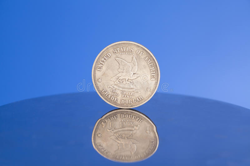 Antique silver american coin. On blue background stock images