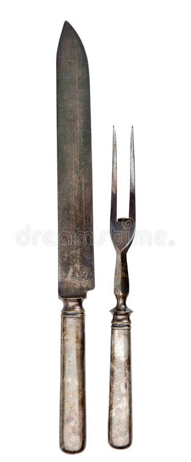 Antique silver carving utensils. stock image