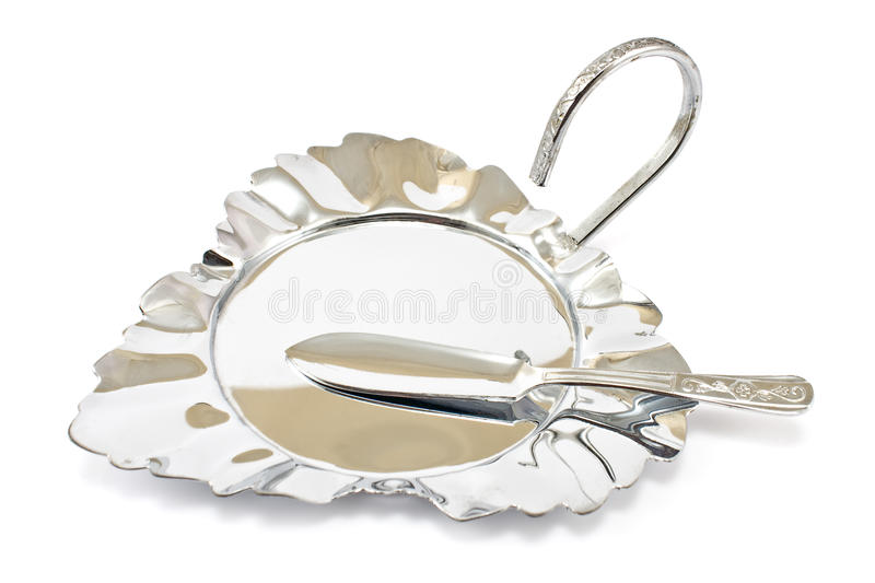 Antique silver plate with knife stock photo