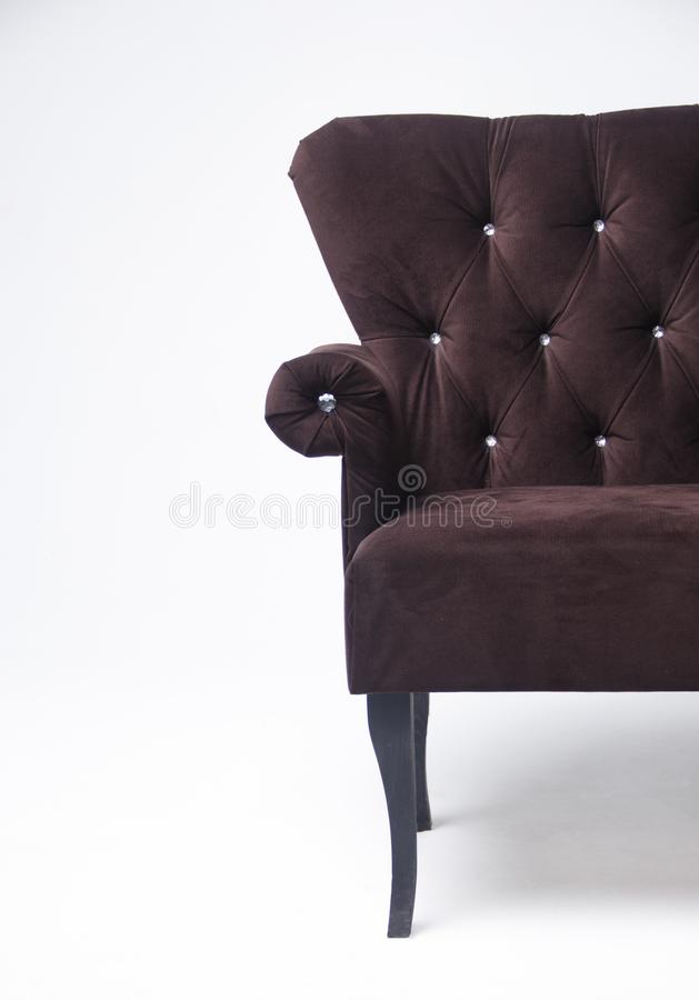 Velvet classic sofa on a light background. Brown sofa with wooden legs stock image
