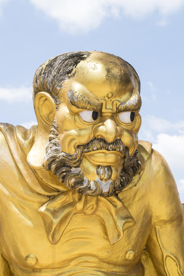 Antique Statue of a Chinese Monk Antique royalty free stock photo