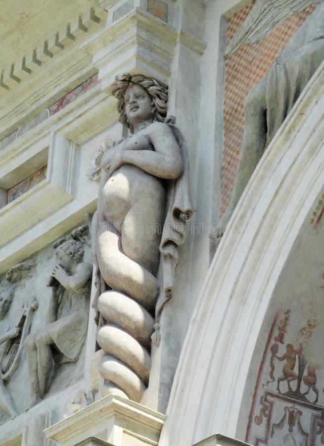 Antique statue of meduza Villa d'Este. Villa d'Este fountains and antique marble statues of gods, woman, mythological creatures and heraldic eagles. Beautiful stock photo