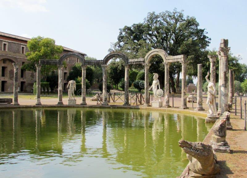Antique statue in Villa Adriana, Tivoli Rome. Ancient antique statue ruins of Villa Adriana in Tivoli near Rome, Italy. The ancient roman ruins of building stock photography