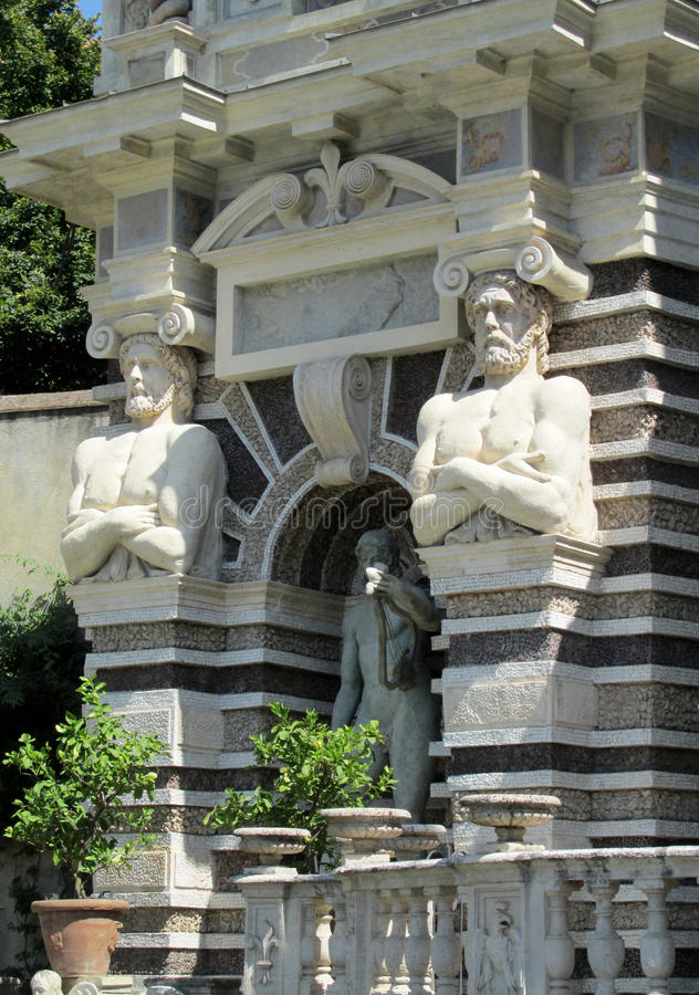 Antique statues of titans Villa d'Este. Villa d'Este fountains and antique marble statues of gods, woman, mythological creatures and heraldic eagles. Beautiful royalty free stock photos