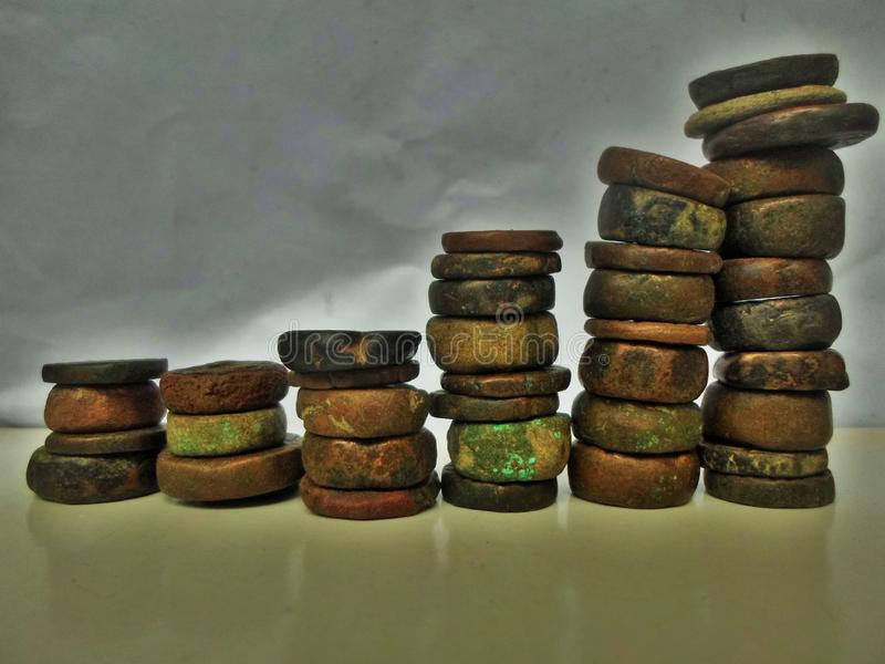 Antique Stone coins graph royalty free stock photo