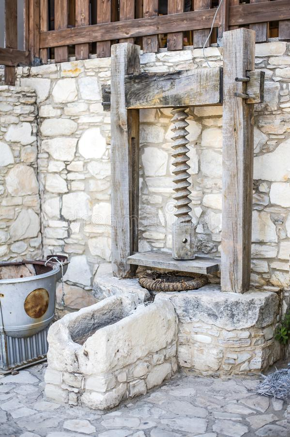 Antique stone fixture with a millstone and a press royalty free stock images