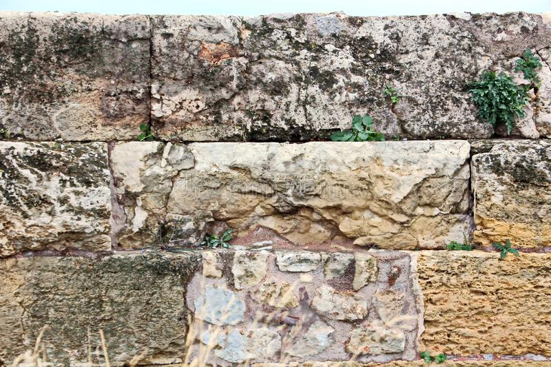 ANTIQUE STONES AND MARBLE USED AT CONSTRUCTION, ACROPOLIS RUINS, GREECE. ANTIQUE STONES,BRICKS AND MARBLE USED FOR BUILDINGS,CONSTRUCTIONS AT ACROPOLIS RUINS stock photography