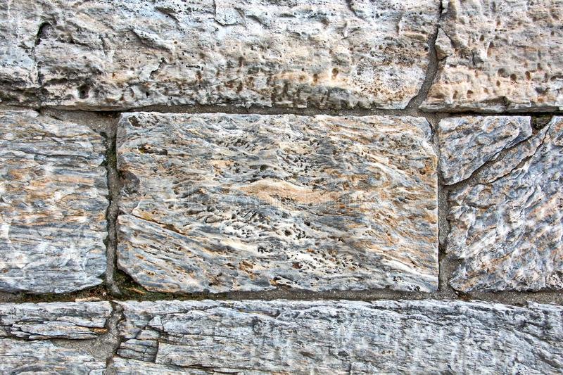ANTIQUE STONES AND MARBLE USED AT CONSTRUCTION, ACROPOLIS RUINS, GREECE. ANTIQUE STONES,BRICKS AND MARBLE USED FOR BUILDINGS,CONSTRUCTIONS AT ACROPOLIS RUINS stock images