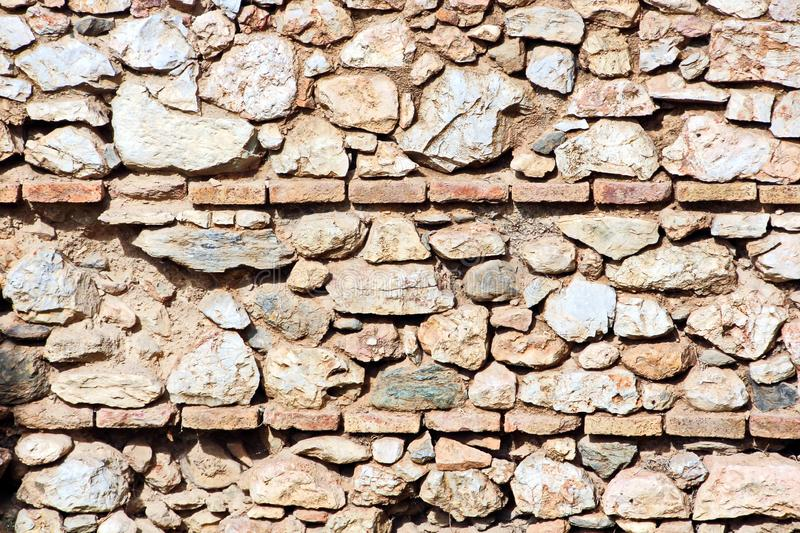 ANTIQUE STONES AND MARBLE USED AT CONSTRUCTION, ACROPOLIS RUINS, GREECE. ANTIQUE STONES,BRICKS AND MARBLE USED FOR BUILDINGS,CONSTRUCTIONS AT ACROPOLIS RUINS royalty free stock images