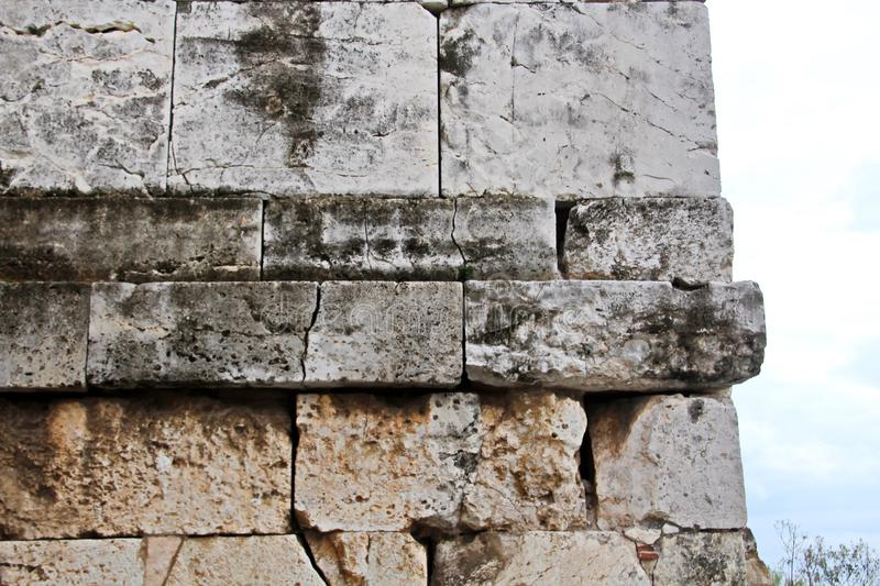 ANTIQUE STONES AND MARBLE USED AT CONSTRUCTION, ACROPOLIS RUINS, GREECE. ANTIQUE STONES,BRICKS AND MARBLE USED FOR BUILDINGS,CONSTRUCTIONS AT ACROPOLIS RUINS stock image
