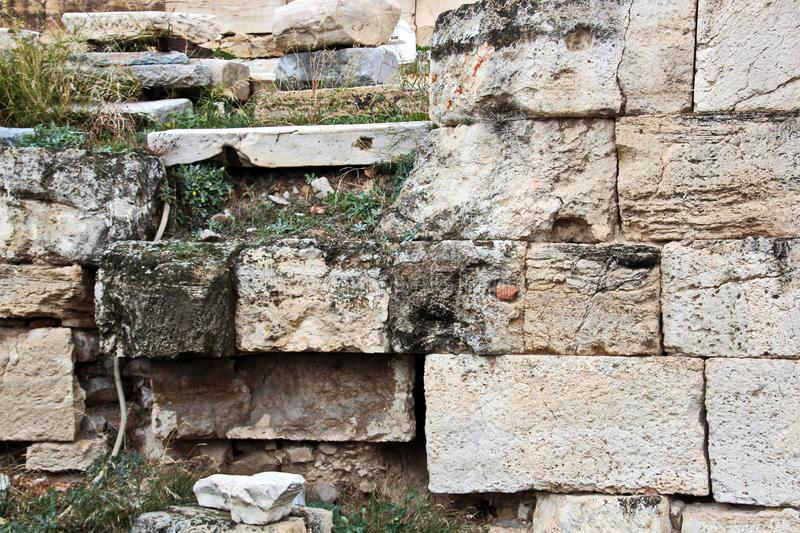 ANTIQUE STONES AND MARBLE USED AT CONSTRUCTION, ACROPOLIS RUINS, GREECE. ANTIQUE STONES,BRICKS AND MARBLE USED FOR BUILDINGS,CONSTRUCTIONS AT ACROPOLIS RUINS royalty free stock photo