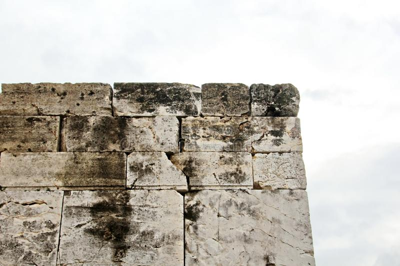 ANTIQUE STONES AND MARBLE USED AT CONSTRUCTION, ACROPOLIS RUINS, GREECE. ANTIQUE STONES,BRICKS AND MARBLE USED FOR BUILDINGS,CONSTRUCTIONS AT ACROPOLIS RUINS royalty free stock photography