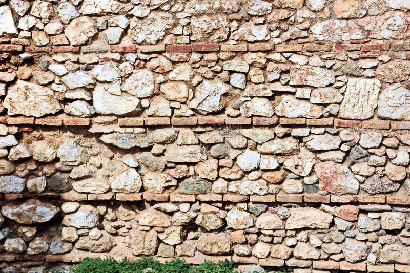 ANTIQUE STONES AND MARBLE USED AT CONSTRUCTION, ACROPOLIS RUINS, GREECE. ANTIQUE STONES,BRICKS AND MARBLE USED FOR BUILDINGS,CONSTRUCTIONS AT ACROPOLIS RUINS royalty free stock image