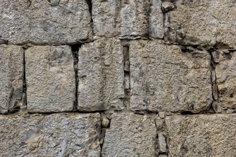 Antique stonewall masonry textured background stock image