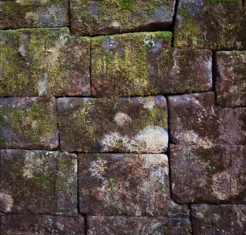 Antique stonework covered with moss. Ancient ruins. Background stock photo