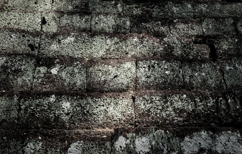 Antique stonework. Fragment of the ancient wall built with stone blocks. Background royalty free stock photography
