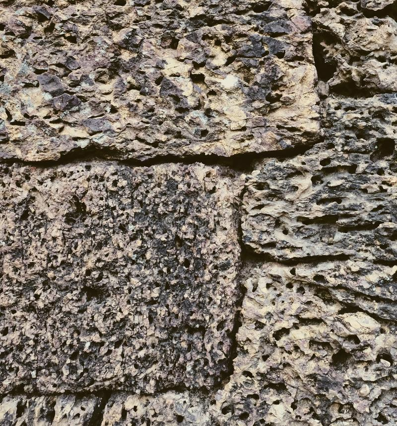 Antique stonework. Stone wall as background. Solid surface.  stock photography