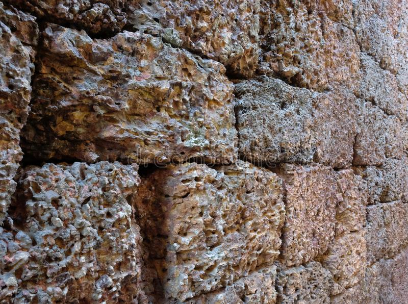 Antique stonework. Stone wall as background. Solid surface.  stock image