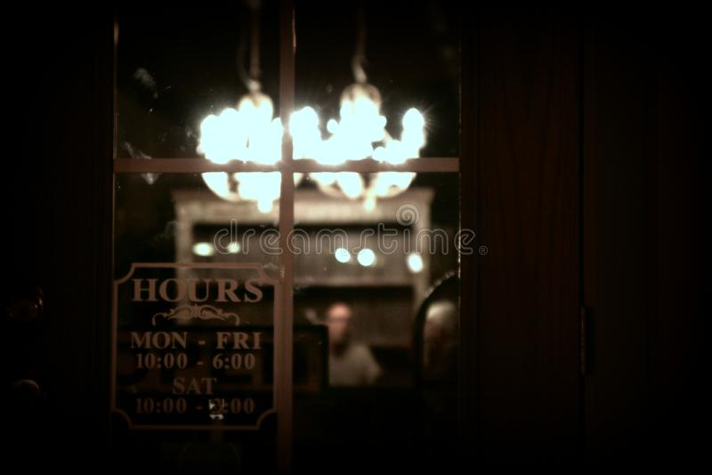Antique store at night thru window pane stock image