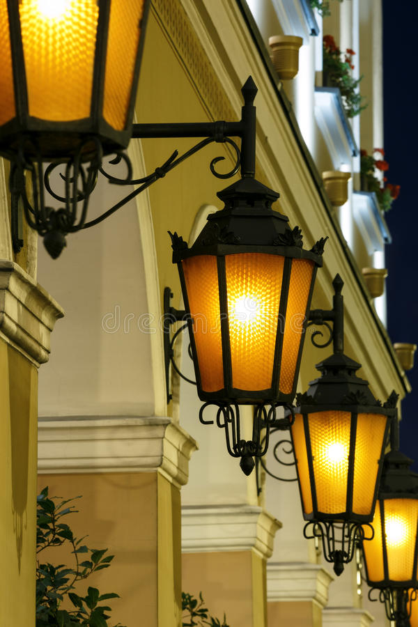 Antique street lights row stock images