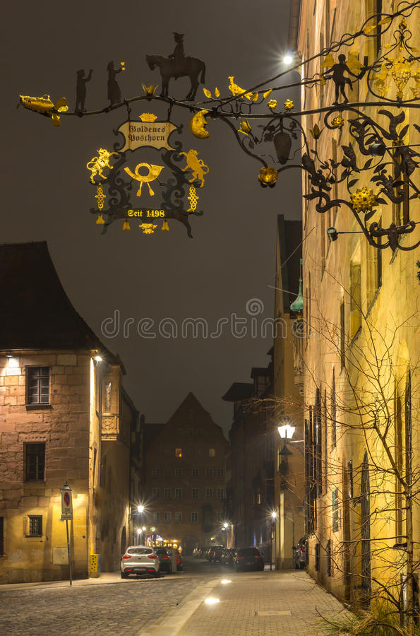 Antique street signboard-Nuremberg, Germany by night royalty free stock photo