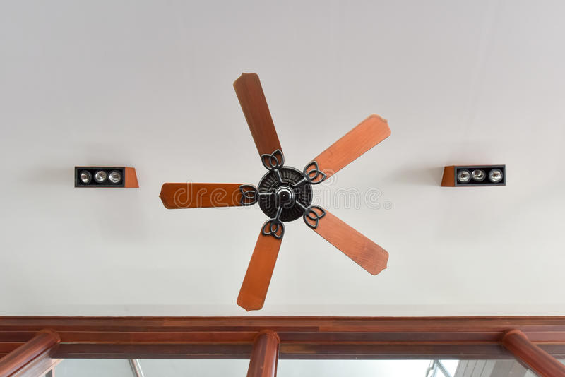 Antique style ceiling fan. In contemporary building royalty free stock image