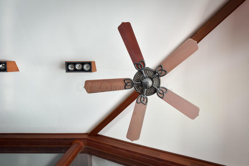 Antique style ceiling fan. In contemporary building stock photos