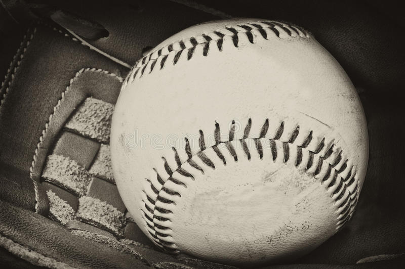 Antique style photograph of baseball and glove royalty free stock images