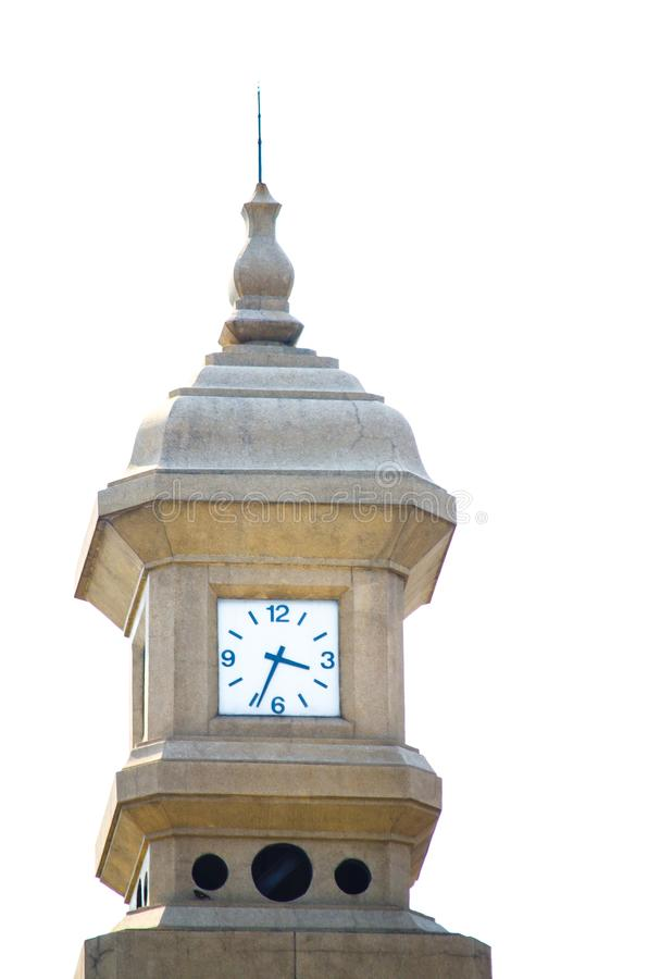 Antique style sandstone clock tower in close up isolated on white background. royalty free stock photo