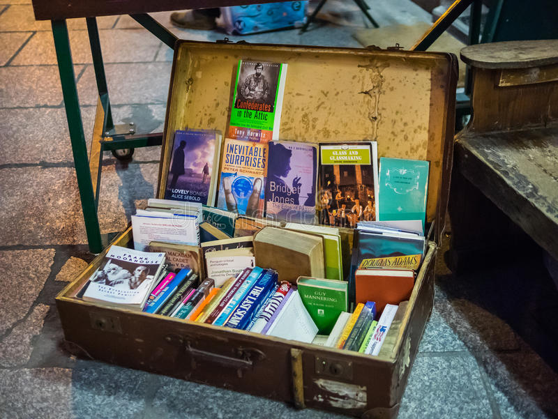 Antique suitcase serves as book display space on sidewalk outside Shakespeare and Company bookstore, paris, France stock image