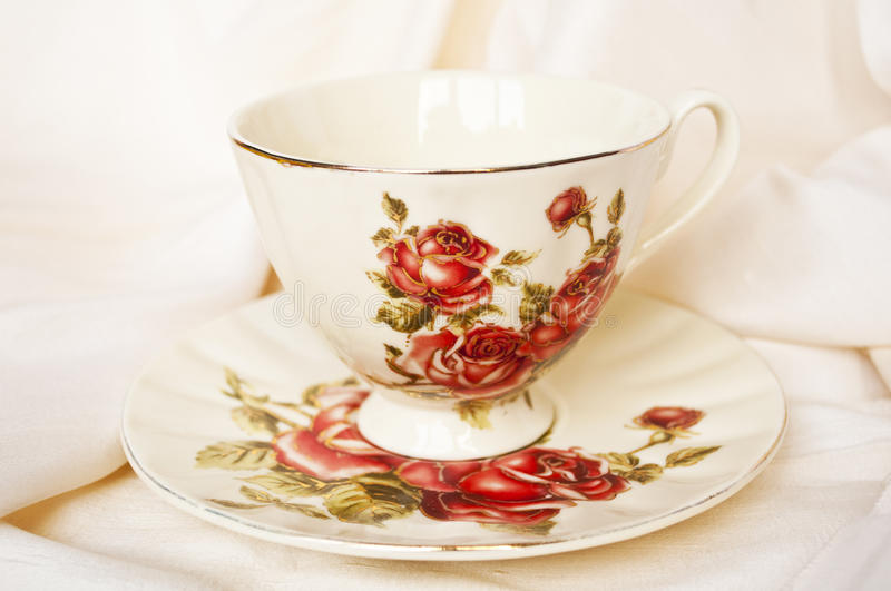 Antique tea cup with roses royalty free stock image