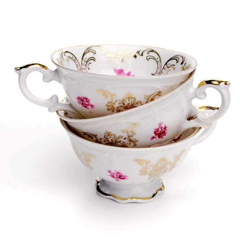 Antique tea cups. On white background royalty free stock photos