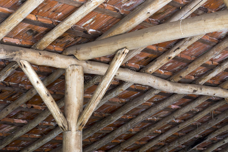 Antique technique of roof construction. HOLAMBRA, SP, BRAZIL - JANUARY 9, 2016 - Old technique of roof construction with slats and wooden columns stock photo