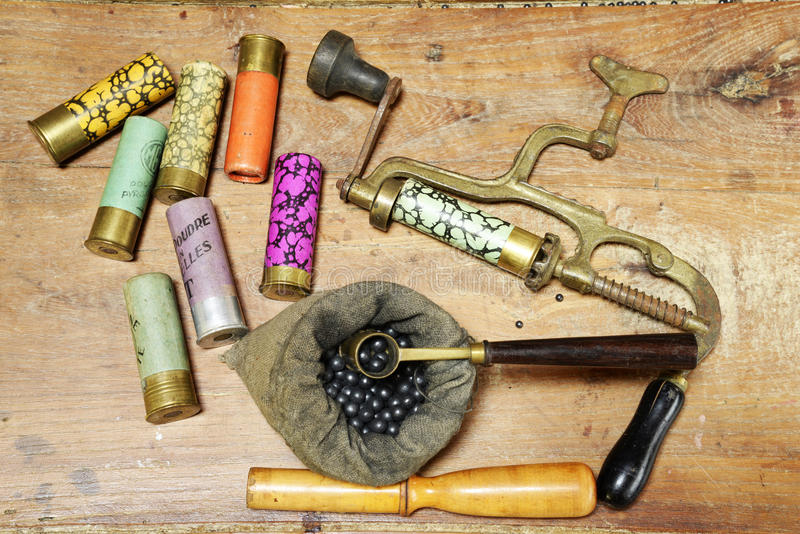Antique tools for rechargering of hunting cartridges. Antique tool for rechargering of hunting cartridges, powder measure, cartridge wad tampers, one litle bag stock images