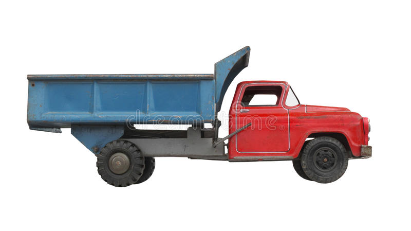 Antique toy dump truck isolated. Antique toy red and blue metal toy dump truck, Isolated on white stock photography