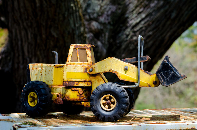Antique toy front end loader. A rusty antique toy front end loader looks like it has had a lot of use and a lot of love over the years royalty free stock photos