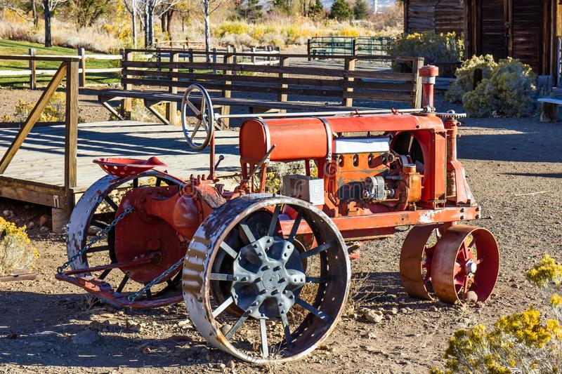 Antique Tractor With Metal Iron Wheels. Antique Tractor With Large Metal Iron Wheels At Local Ranch In Early Morning royalty free stock photography