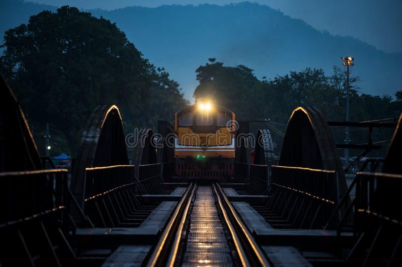 Antique train on river Kwai bridge stock photo