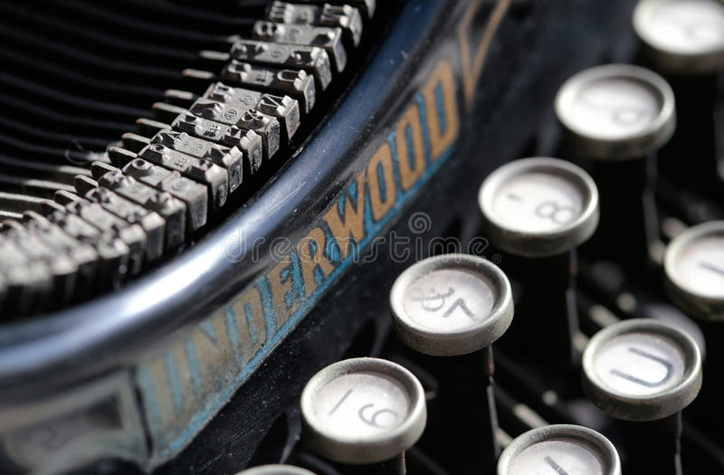 Antique typewriter from beginning 20th century at industry exhibit in an art gallery. Antique typewriter from beginning 20th century shown at a industry antique stock image